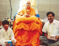 Mr. Rajiv Podar and Master Vedant Podar with Holy Saint Pujya Pramukh Swamiji Maharaj